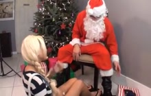Santa claus gets foot job from blond babe