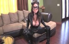 Catwoman with big tits rubs pussy with a vibrator